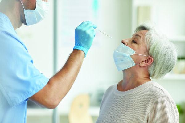 doctor taking test swab 5RUAWAX